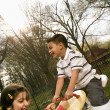 Stockfoto: Young Girl and Boy Playing on Seesaw