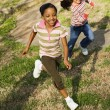 Young Girls Running on Grass - Stock Photo