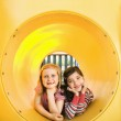 Young Girls Lying Together in Crawl Tube — Stock Photo