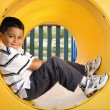 Young Boy Lying in Crawl Tube — Stock Photo #9228399