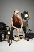 Woman with studio lights. — Stock Photo