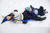Boy and girl in snow. — Stock Photo