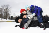 Family stacked in snow. — Stock Photo