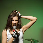 Female singing into mic. — Stock Photo