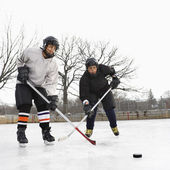 Boys playing ice hockey. — Stock Photo