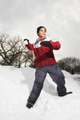 Boy throwing snowball. — Stock Photo