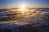 Ice on road at sunrise. — Stock Photo