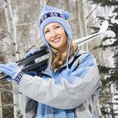 Female holding skis. — Stock Photo