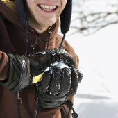 Teenager making snowball. — Stock Photo
