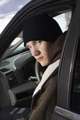 Teenager sitting in car. — Stock Photo