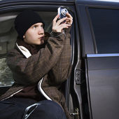 Teenager taking a picture. — Stock Photo
