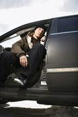 Teen sitting in car. — Stock Photo