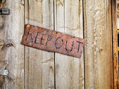 Sign on Old Door — Stock Photo