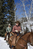 Man and Woman Riding Horses in the Snow — Stock Photo