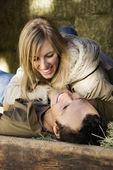 Couple in hay. — Stock Photo