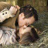 Kissing couple in hay. — Stock Photo