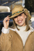 Woman tilting cowboy hat. — Stock Photo