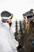 Two Skiers Smiling at Each Other — Stock Photo
