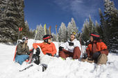 Skiers Sitting in Snow Talking — Stock Photo