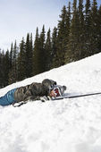 Skier Lying in Snow — Stock Photo