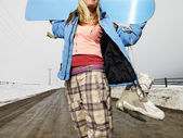 Woman holding snowboard. — Stock Photo