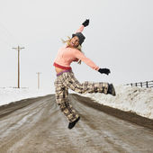 Woman jumping joyfully. — Stock Photo