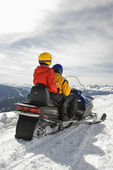 Couple on snowmobile. — Stock Photo