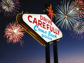 Leaving Las Vegas Sign With Fireworks in Background — Stock Photo
