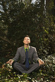 Young Businessman Sitting in Meditation — Stock Photo