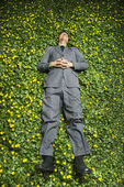Young Businessman Lying in Flower Patch — Stock Photo