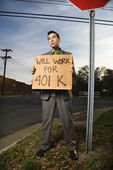 Young Businessman Holding 401k Sign — Stock Photo