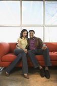Couple sitting on couch. — Stock Photo