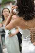 Back of woman in evenging gown. — Stock Photo