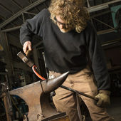 Metalsmith shaping metal. — Stock Photo