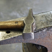 Hammer and anvil. — Stock Photo