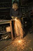 Metalsmith creating sparks. — Stock Photo