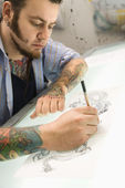 Man drawing tattoo. — Stock Photo
