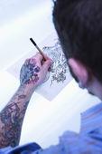 Tattoo umělec kresba. — Stock fotografie