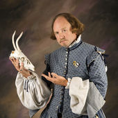 Shakespeare with deer skull. — Stock Photo