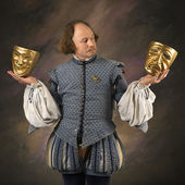 Shakespeare with theatrical masks. — Stock Photo