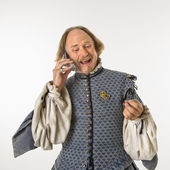 Shakespeare talking on phone. — Stock Photo