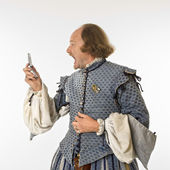 Shakespeare screaming at cell phone. — Stock Photo
