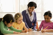 Teacher Helping Students — Stock Photo