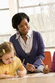 Teacher Smiling and Helping Students With Schoolwork — Stock Photo