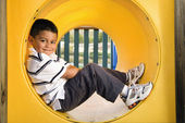 Young Boy Lying in Crawl Tube — Stock Photo