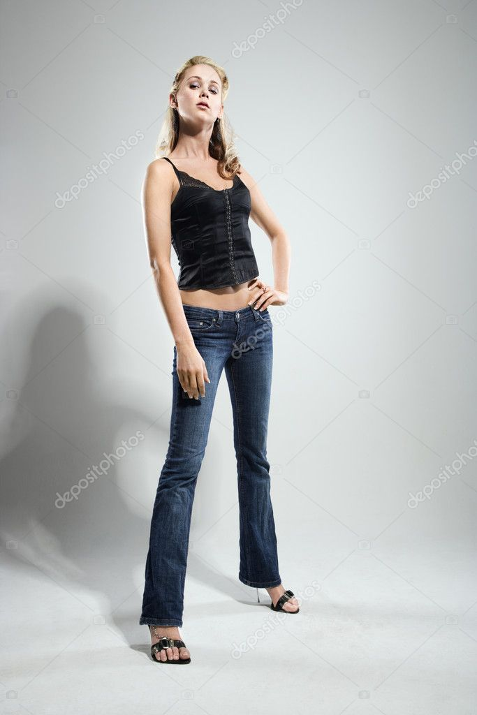 Full length studio portrait of pretty blonde Caucasian young woman.  Stock Photo #9221691