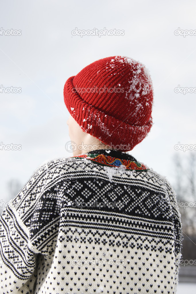 Back view of Caucasian boy wearing sweater and red winter cap. — Stock Photo #9222061