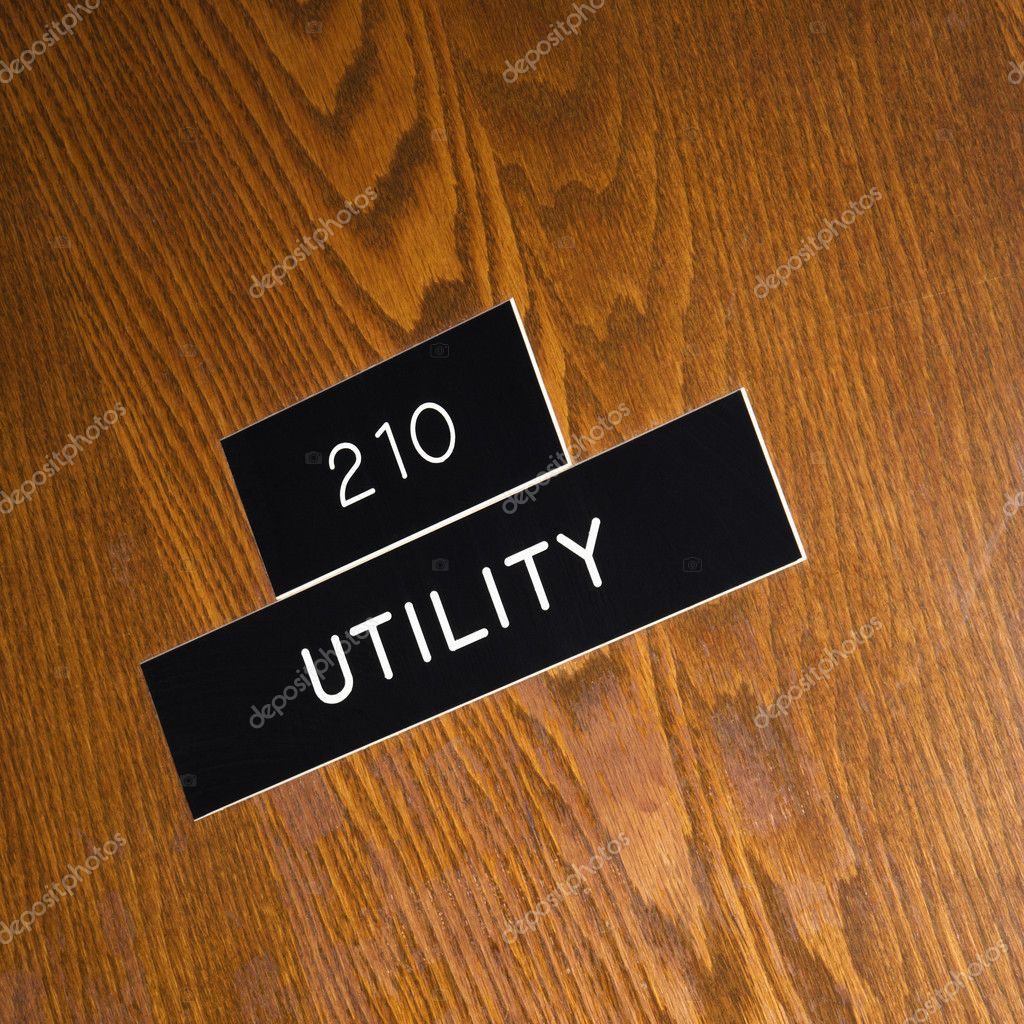 Shot of utility sign on wooden door.  Stock Photo #9224179