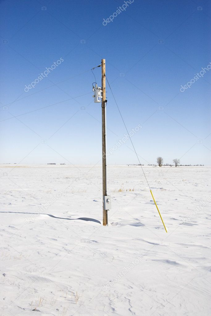 Power line in desolate snow covered rural landscape. — Stock Photo #9224936
