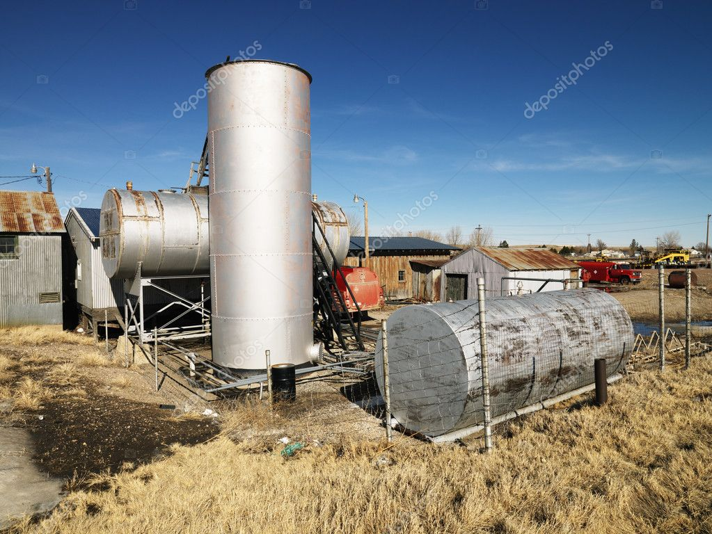 Rural landscape with metal tanks.  Stock Photo #9225399